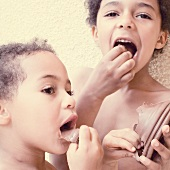 A girl and a boy eating chocolate