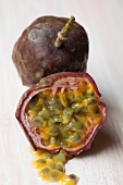 A whole and a halved passion fruit