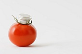 Fresh vine tomato with bottle cap on top of it