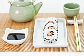 Place setting for Japanese meal of maki sushi