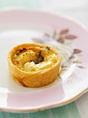 A mini tartlet with caramelised onions and feta cheese
