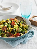 Corn salad with tomatoes, avocados, olives and basil