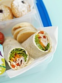 Chicken wraps in a lunchbox (close-up)