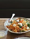 Spaghetti with chicken, tomato pesto and feta cheese