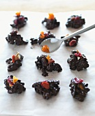 Chocolate crispy cakes (chocolate, nut and dried fruit cakes)
