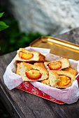 Nectarine slices in a picnic tin