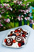Chocolate Swiss roll with cream and berries