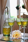 Blossom, glasses and carafe on table