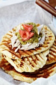 Grilled Naan Topped with Pulled Pork, Salsa Verde and Tomato