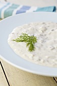 Bowl of Clam Chowder with Dill Garnish