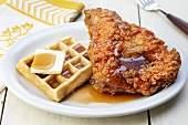 A Waffle and Fried Chicken with Maple Syrup and Butter