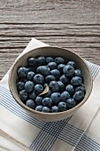 Organic Maine Blueberries in a Gray Ceramic Bowl on a Blue Striped Towel