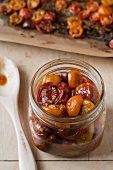 Slow Roasted Cherry Tomatoes in a Glass Jar; Sheet of Roasted Cherry Tomatoes