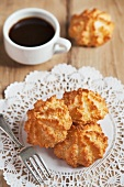 Coconut Macaroons on a Doily with a Cup of Coffee