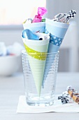 Paper cones held together with masking tape as holders for sweets