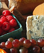 Wedge of Blue Cheese with a Pint of Raspberries and Fresh Grapes