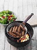 Honey and rosemary sausages on a table barbecue