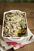 Sausage and Swiss Chard Strata in a Casserole Dish; Scoop Removed