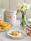 Lemon tartlets, a biscuit tin and a bunch of flowers
