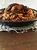 Orange chicken with oven-roasted vegetables and couscous