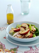 Peach and chicken salad with pecan nuts