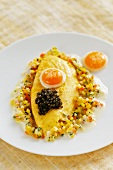 Quail's egg omelette on a bed of vegetable vinaigrette with beluga caviar