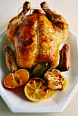 Roast chicken with citrus fruits and garlic