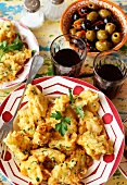 Cod fritters, red wine and olives