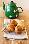 Scones on a wire rack with a teapot