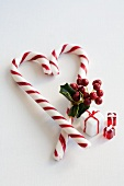 A candy cane heart with holly and glass decorations