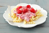 Fusilli with berry yogurt and raspberries