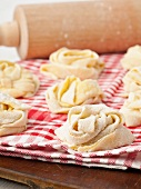 Handmade tagliatelle nests made of durum wheat semolina