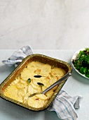 Cheesy Potato Casserole in Baking Dish with Scoop Removed