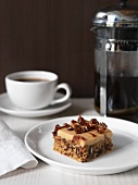 Date and creme slice and a cup of coffee