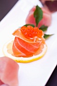 Salmon Sushi Topped with Caviar on a Lemon Slice; Assorted Sushi