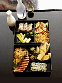 Japanese Bento Box with Sukiyaki, Tempura Vegetables and Sushi