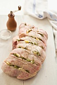 Leg of Lamb with Slits Stuffed with Garlic and Rosemary; Tied and Ready for Roasting