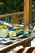 Glasses of Lemonade and Salad in a Glass Bowl on Outdoor Patio Table