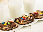Walnut M&M Brownies with Glasses of Milk