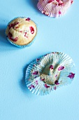 Redcurrant muffins and empty paper cases