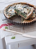 Roquefort and spinach pie in a baking tin, sliced