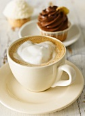A cappuccino with cupcakes