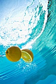 Lemon floating in swimming pool