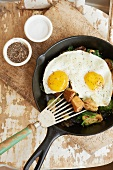 Vegetable Hash Topped with Two Sunny Side Up Eggs in a Skillet