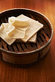 Wonton Wrappers Stacked on Steamer
