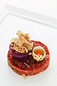 Beef tartar with oven-roasted onions, alba truffles and quail's eggs