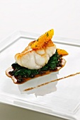 Monk fish with spinach and citrus fruit powder