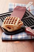 Freshly baked waffles in a waffle iron
