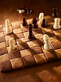 A chessboard cake with chocolate figures