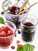 Three types of berry jam in glasses